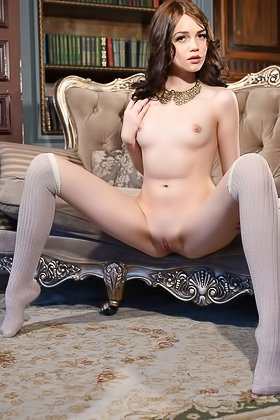 Redhead with perfect legs showing off on a big, luxurious sofa Videos