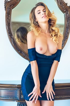 Busty blonde takes off her skintight navy blue dress and poses naked Videos