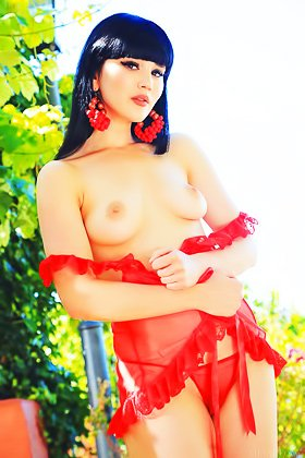 Pale-skinned brunette dressed in a scarlet-colored outfit gets naked Videos