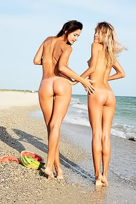 Two gorgeous GFs in striped outfits eating a watermelon, naked, on a beach Videos