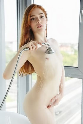 Redheaded girl in white showing her pubes while taking a bath Videos