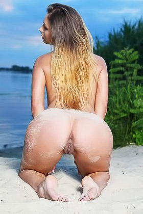 Leggy blonde with a perfect body posing half-naked in the sand Videos