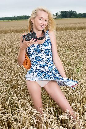 Playful blond-haired Latvian teen strips naked in the wheat field Videos