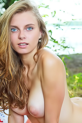 Wavy-haired blondie takes off her white panties while chilling outdoors Videos