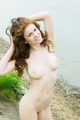 Curly-haired redhead showing her gorgeous pussy by the window Videos