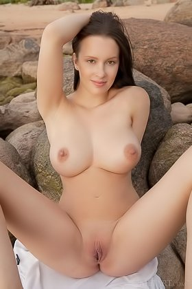 Buxom brunette bravely exposing herself on the rocky shoreline Videos