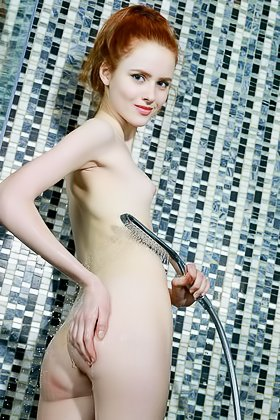 Redheaded Russian girl showing her flawless wet body in the shower Videos