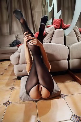 Leggy blonde in a pantyhose shows her marvelous ass on camera Videos