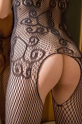 Leggy blonde in a fishnet bodysuit freely shows it all on camera Videos