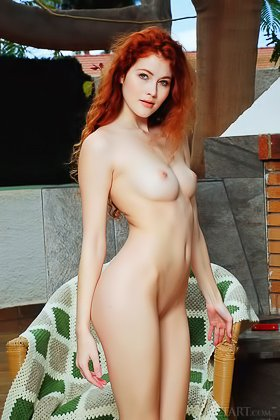 Czech Redhead spreads her legs while posing nude in an armchair Videos