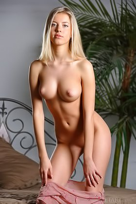 Young blonde with big boobs shows off her body while on camera Videos