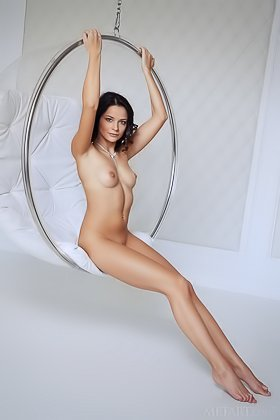 Sun-kissed brunette vixen posing naked in a pricey egg chair Videos