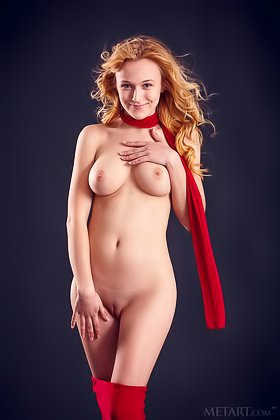 Redheaded seductress in red goes on all fours to show her breasts Videos