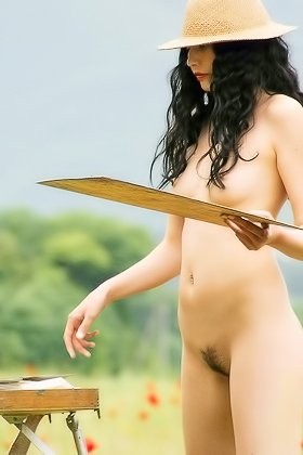 Raven-haired beauty with bangs roams a beautiful field while naked Videos