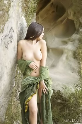 Dark-haired model posing nude in a desolate cave, somewhere in Egypt Videos