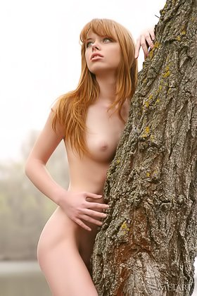 Innocent redhead posing naked in a somewhat moody solo gallery Videos