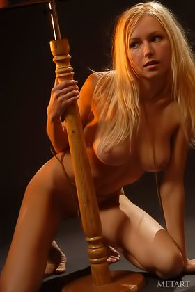 Sweaty young blonde showing off her nude body in a dimly-lit room Videos