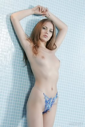 Cutesy redhead in a strange two-piece swimsuit posing naked by the pool Videos