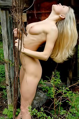 Slim young blonde with a firm butt shows her goodies in the woods Videos