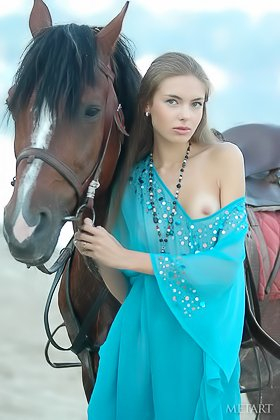 Horse girl posing next to a wild stallion in a outdoor erotic shoot Videos