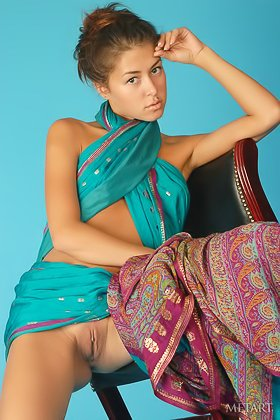 Barely legal seductress posing in a traditional outfit before stripping Videos
