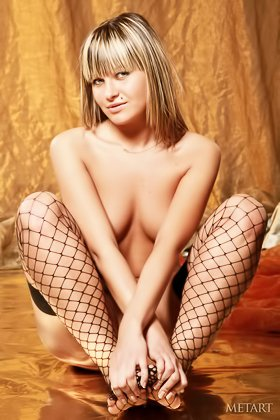 Adorable blonde with bangs posing in her seductive fishnet stockings Videos