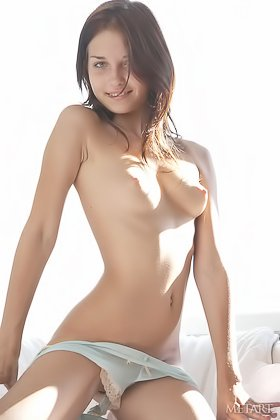 Long-legged girl posing happily in a white room, stripping naked Videos