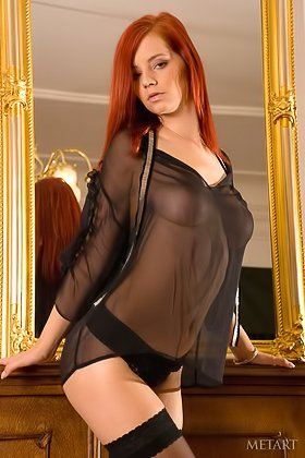 Red-haired babe in a see-through attire showing off by the mirror Videos
