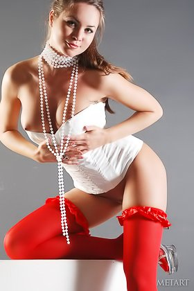 Gorgeous brunette dressed in white and red striking seductive poses Videos