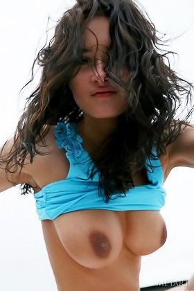 Busty and tanned brunette playing with your mind on the boat Videos