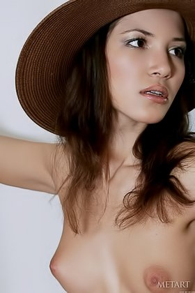 Hat-wearing brunette teasing you with her smoldering body and hot tits Videos