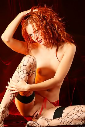 Redheaded in ripped mesh stockings presents her perfect labia Videos