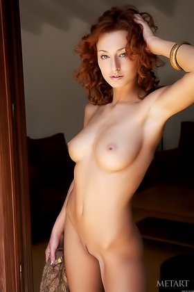 Wild-haired redhead showcasing her long legs and perfect breasts Videos
