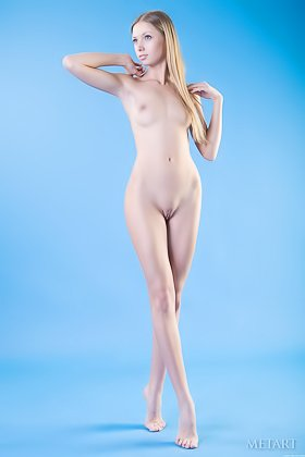 Angelic blonde with long legs shows that nude body in a blue room Videos
