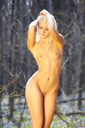 Young blonde smells flowers before stripping naked in the woods Videos