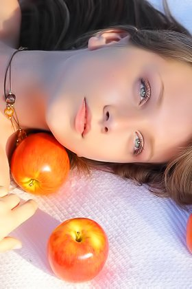 Dark-haired chick poses naked while surrounded by lots of apples Videos