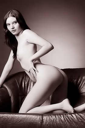 Barely legal brunette beauty shows her ass on a leather couch Videos