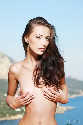 Fit brunette striking sexy poses on a hill with her boobs out Videos