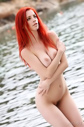 Redhead that looks like a supermodel posing naked by the water Videos