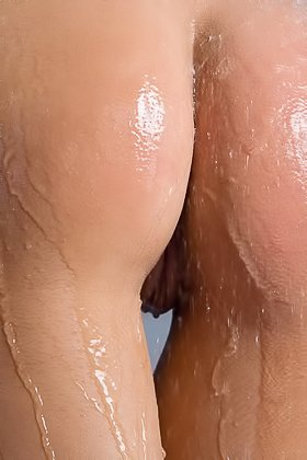 Wet brunette splashing and showing off her flawless tanned body Videos