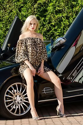 Blonde with a fully natural body posing next to some fancy car Videos