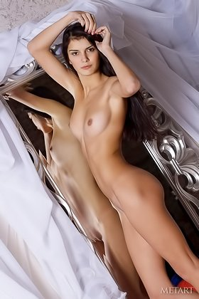 Big-breasted brunette showing her body in front of a large mirror Videos