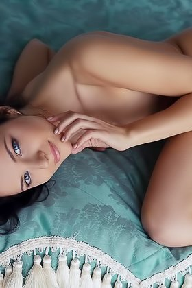 Brunette with messy hair shows her delicious pussy while posing on a bed Videos