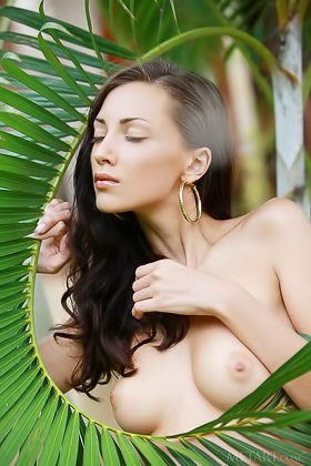 Captivating brunette with big breasts shows her boobs while outside Videos
